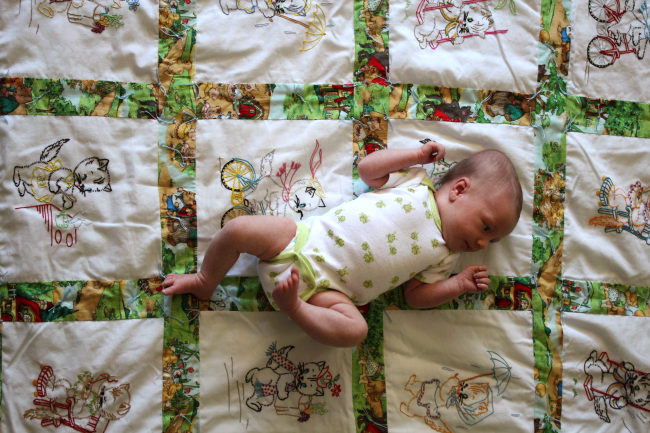 Alexis on Great Grandma's Quilt